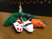 Some of the completed draft snakes. Hot-glued felt details and hand- sewn edges. This was a multi-day project at both schools that I felt went really well. All of the children participated and all of them sewed their snakes completely by themselves.