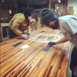 The awesome ADX Fab team finishing a table for the Oregon Dept. of Energy.